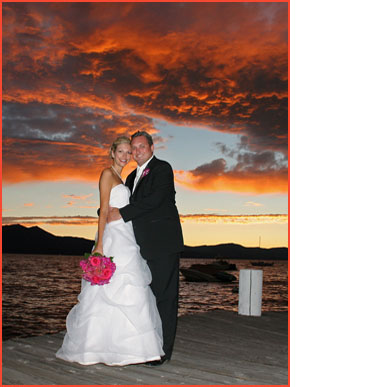 A beach sunset with the newlyweds on the pier