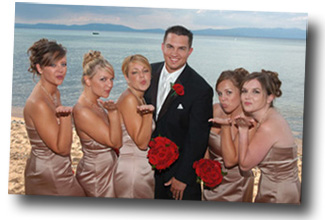 The groom on the beach with the bridesmaids