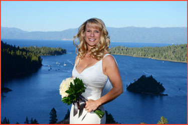 Bride poses on the bluff of Emerald Bay