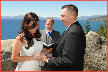 Bride exchanges rings with her groom during their ceremony