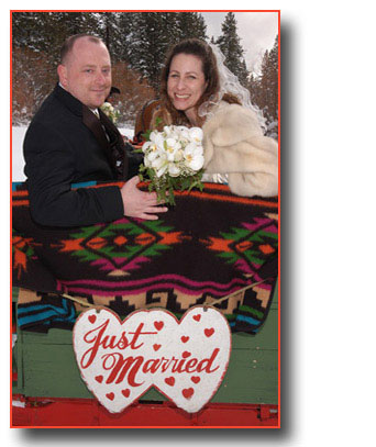 Looking back over the sleigh, the smiling newlyweds were just married