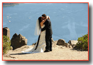The first kiss of the newlyweds on the bluff of Emerald Bay