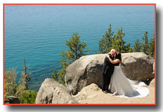Distant photo of the bride and groom on the overlook of Logan Shoals