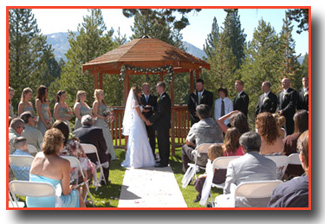A ceremony being performed at the park gazebo