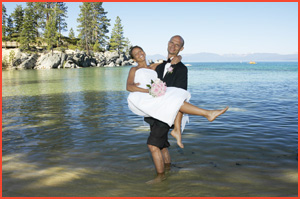 Bride and groom in the water at Sand Harbor