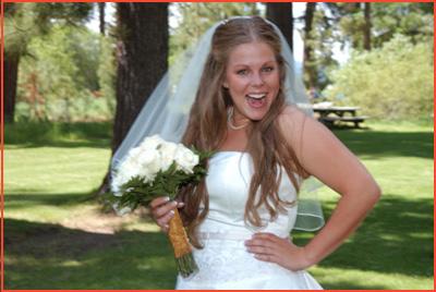 Pretty bride smiles at Regan Beach