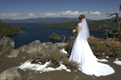 Bride's dress from behind as she looks out over the bay