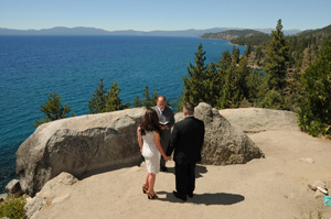 A ceremony taking place on the overlook at Logan Shoals