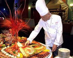 The chef serving the meals at the reception
